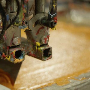 Close-up of screenprinter in action