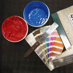 Tools of the trade: ink, pantone swatches, squeegees, and pallet knife